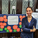 "College of Arts & Sciences Student Madeleine Stevens with her poster entitled, ""Is Feminism Still Relevant?"""