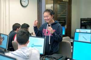 Belinda Liu explains Solidworks modeling to students in our MEAM lab.